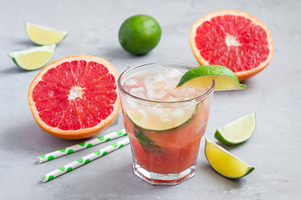 Cold pink cocktail with fresh grapefruit lime and ice cubes picture id601130174?b=1&k=6&m=601130174&s=612x612&w=0&h=3epwowqfrprbgwdn3xorb58z1pe6cmf6 clfiz  lby=