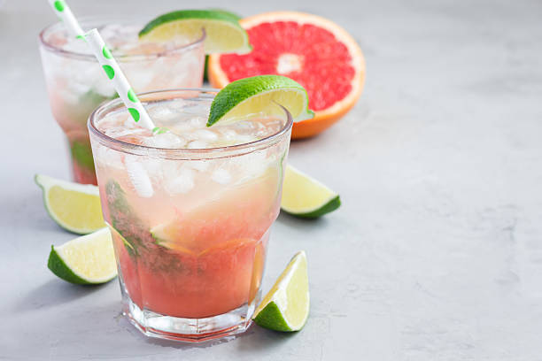 cold pink cocktail with fresh grapefruit, lime, copy space - margarita drink stock photos and pictures