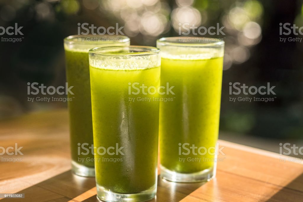 Cold Pressed Juice of Spinach, Nopal, Cucumber, Pineapple, Parsley, Orange Juice stock photo