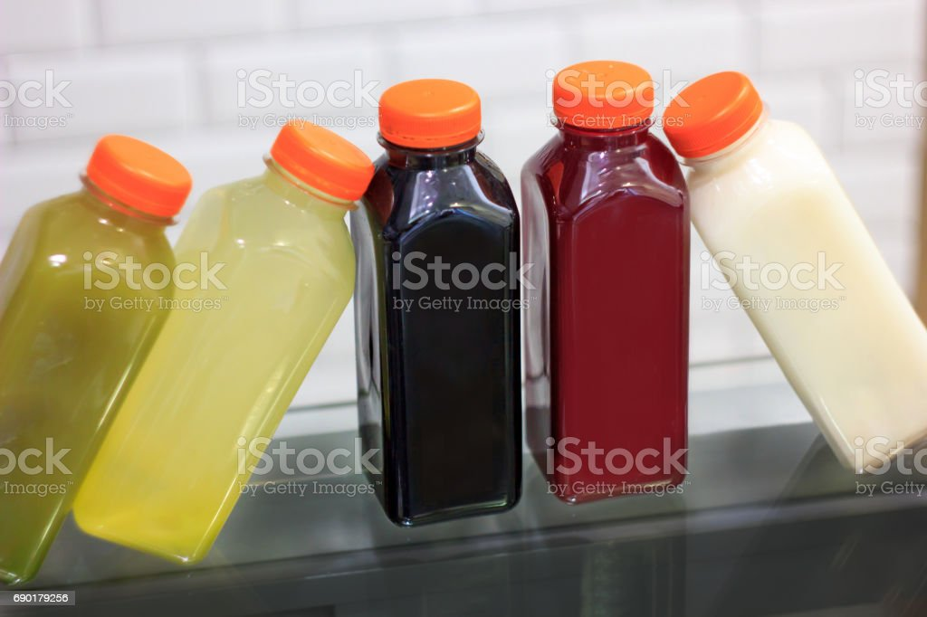 Cold pressed juices in bottles stock photo