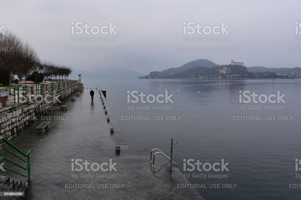 Arona, Italy - February 2, 2017: Cold rainy morning by Lago Maggiore stock photo