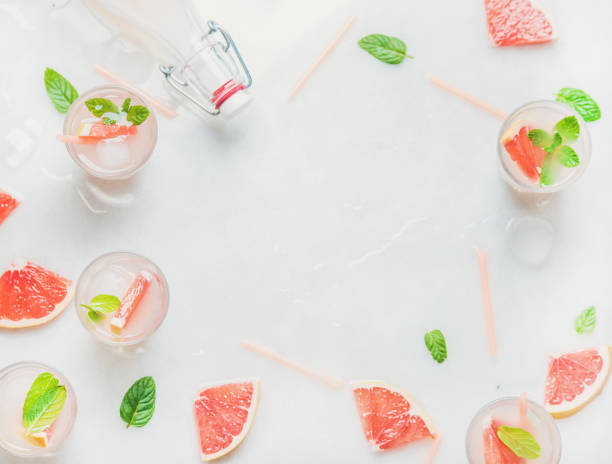 cold refreshing alcohol cocktail with fresh grapefruit, copy space - grapefruit cocktail stock photos and pictures