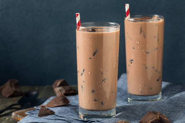 Cold Refreshing Iced Hot Chocolate Milk Cold Refreshing Iced Hot Chocolate Milk with Ice chocolate milk stock pictures, royalty-free photos & images