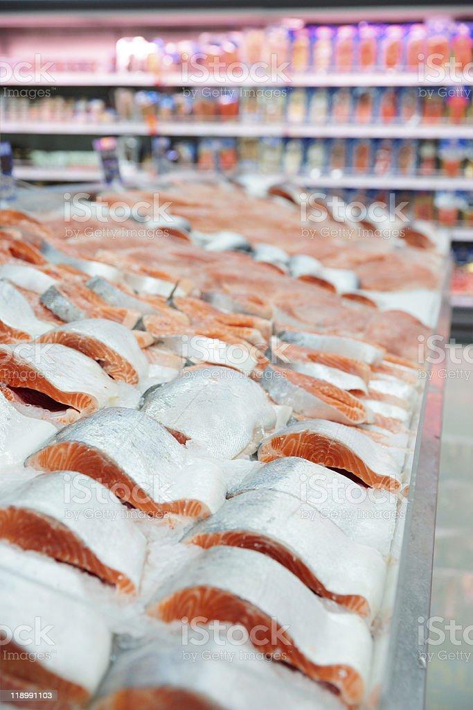 A cold salmon display at a market royalty-free stock photo