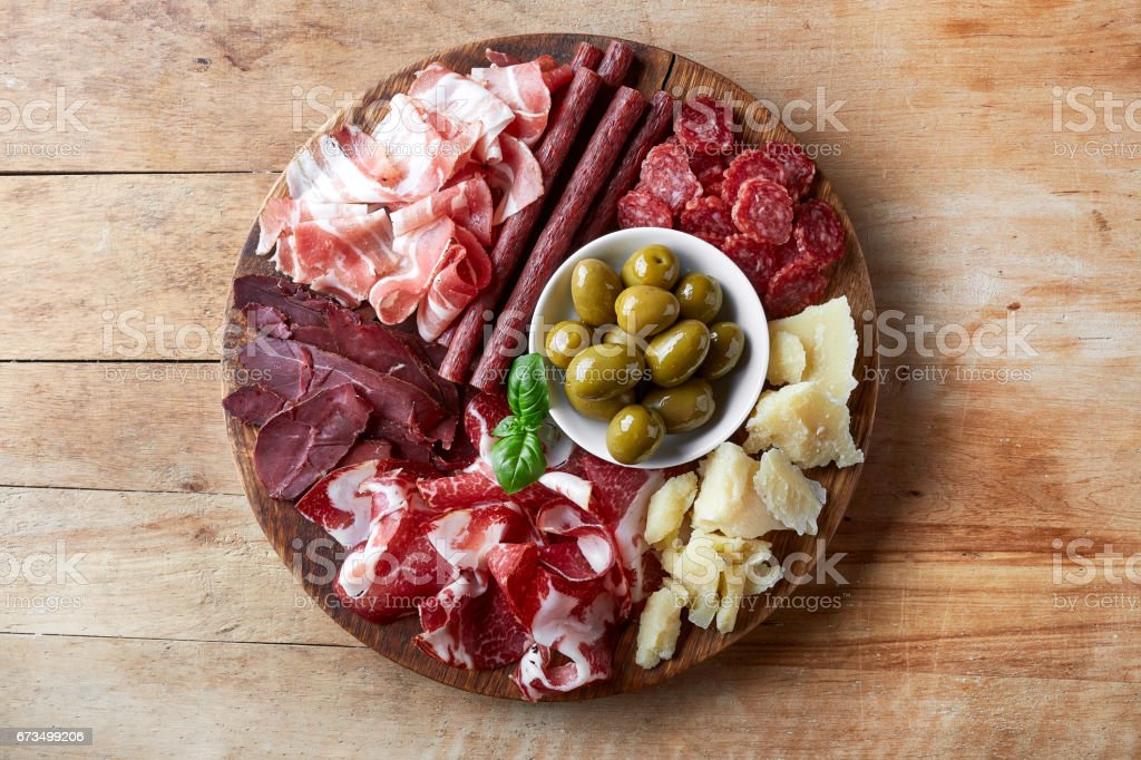 Cold smoked meat and cheese plate stock photo
