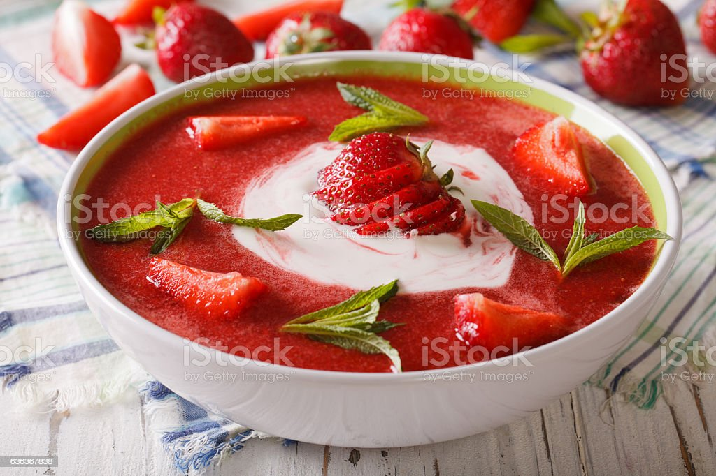 cold strawberry soup with mint and sour cream stock photo