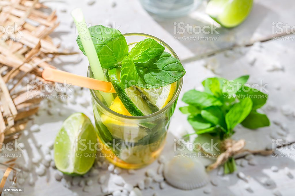 Cold summer drink with lemon and lime stock photo
