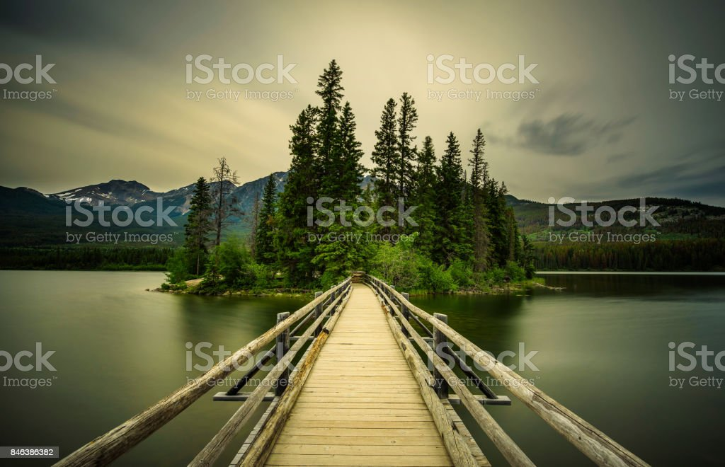 Cold summer evening at the Pyramid Lake and the little Pyramid Island in Jasper National Park stock photo