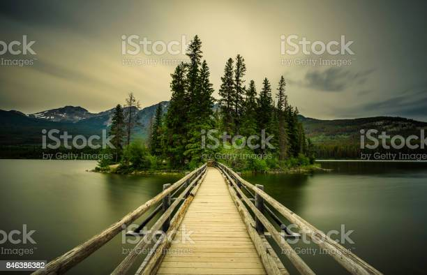 Photo of Cold summer evening at the Pyramid Lake and the little Pyramid Island in Jasper National Park