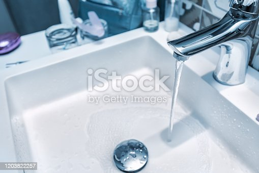 istock Cold water stream from the open tap in the bathroom 1203822257