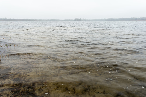istock cold water surface in fog with barely visible blurred distant shore on the horizon 1188720283