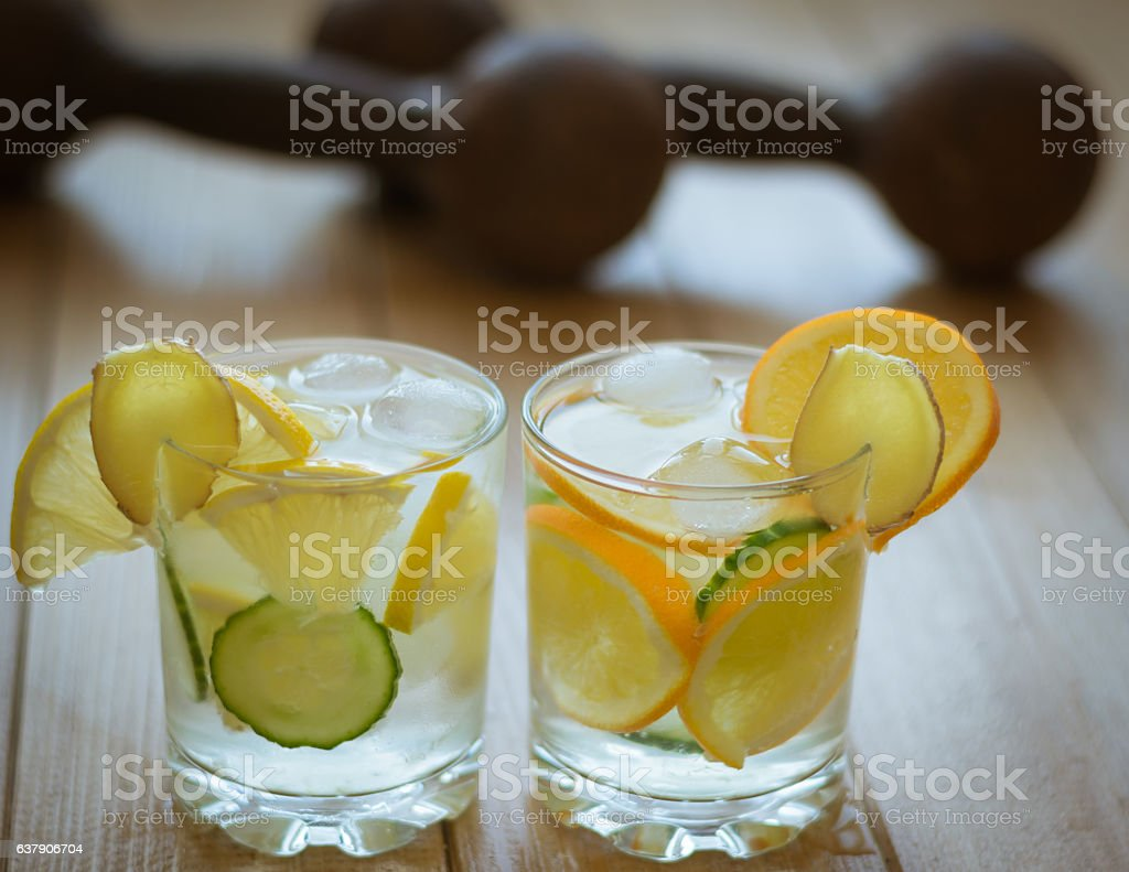 Cold water with lemon, ginger and cucumber. stock photo