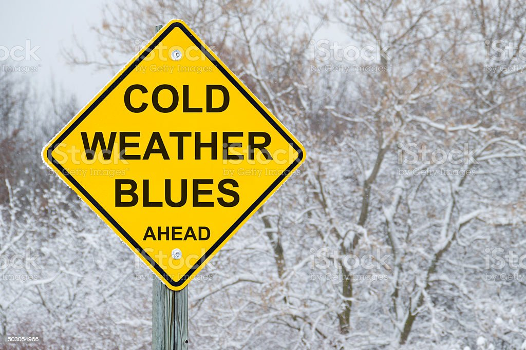 Cold Weather Blues Ahead Road Sign stock photo