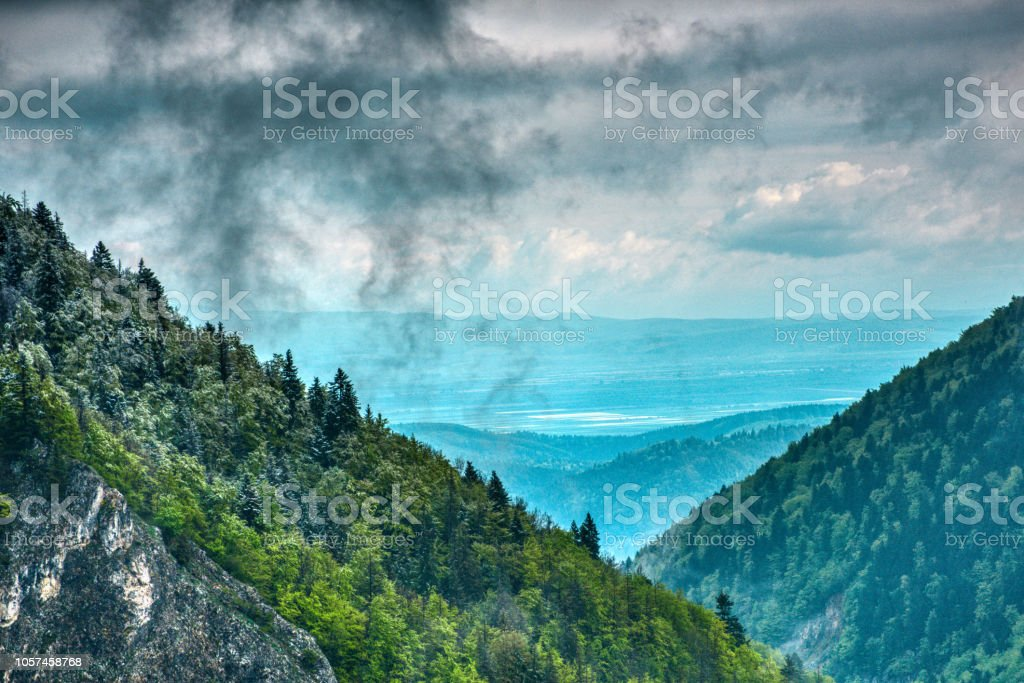 horizontal nature background with stormy gray clouds in winter day.