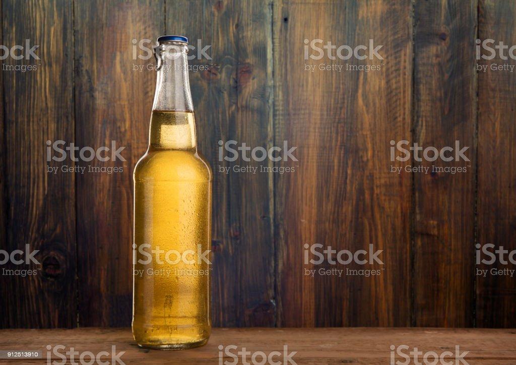 Cold wet beer bottle stock photo