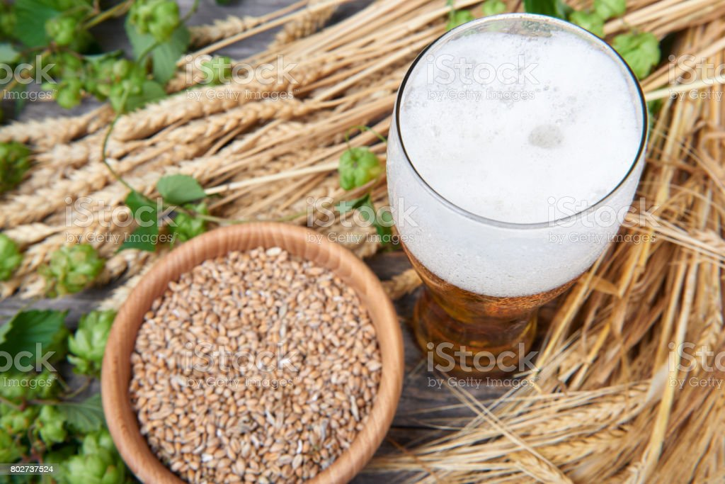 Cold wheat bear in glass on the wooden table stock photo