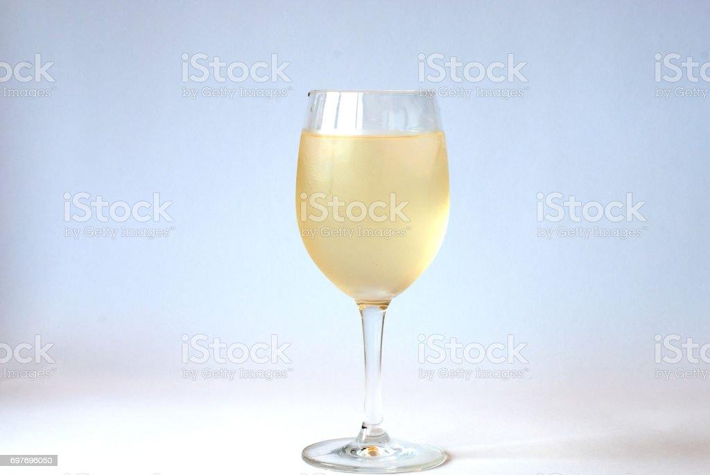 Cold white wine in a glass stock photo
