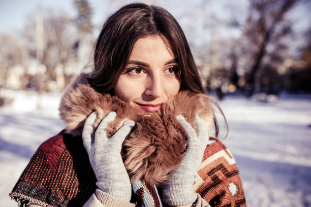 Cold winter for young woman stock photo