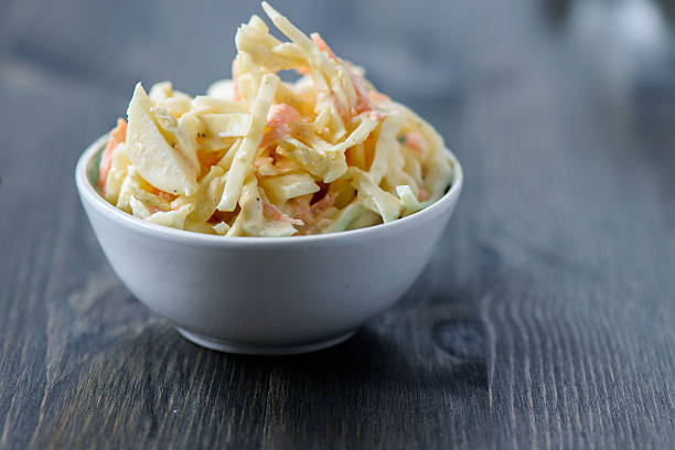 coleslaw in a bowl on  wooden table - coleslaw stock pictures, royalty-free photos & images