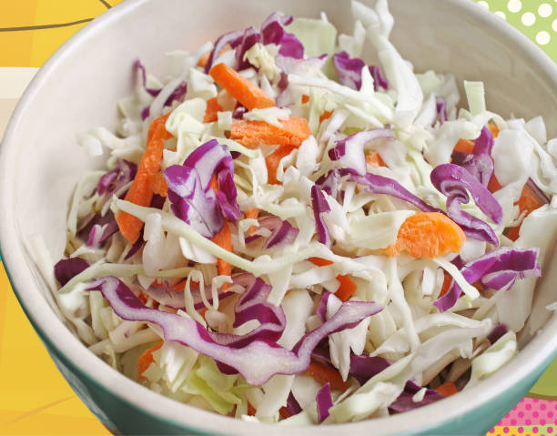 coleslaw of freshly chopped green and red cabbage and carrots - coleslaw stock pictures, royalty-free photos & images