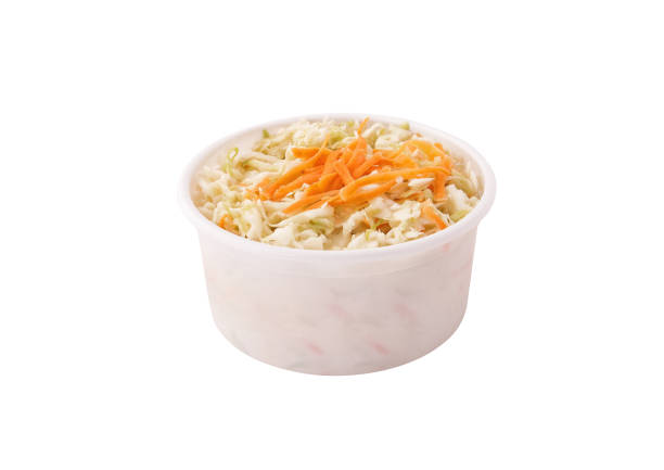 coleslaw salad in plastic container bowl isolated on white background - coleslaw stock pictures, royalty-free photos & images