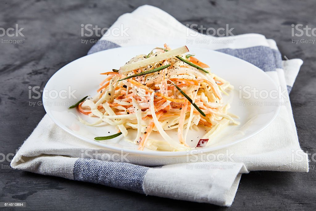 Coleslaw salad on white plate stock photo