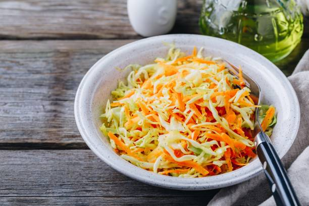 coleslaw salad with white cabbage, carrots and mayonnaise dressing - coleslaw stock pictures, royalty-free photos & images