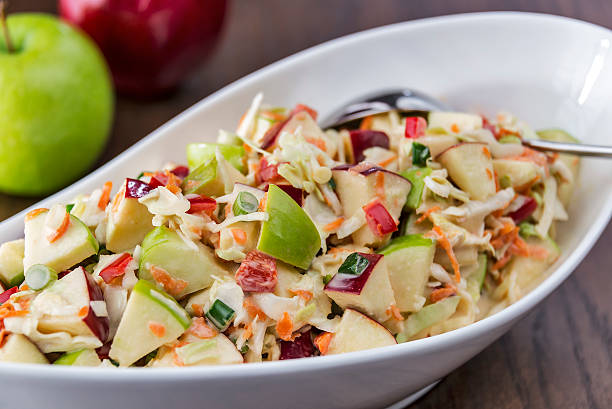coleslaw with green and red apples - coleslaw stock pictures, royalty-free photos & images