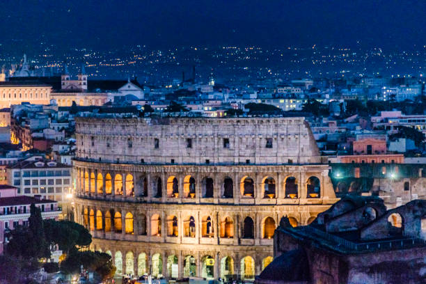Coliseum Aerial view Night Scene, Rome Night scene aerial of rome coliseum view from Vittorio Emanuele II viewpoint, Rome, Italy rome stock pictures, royalty-free photos & images
