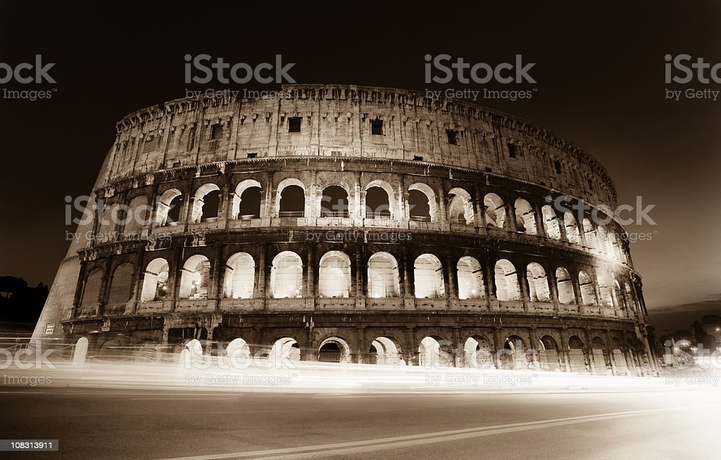 Coliseum by night with traffic, Roma Italy royalty-free stock photo