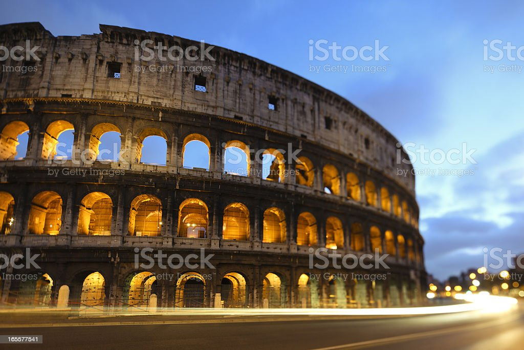 Coliseum by night with traffic, Rome Italy royalty-free stock photo