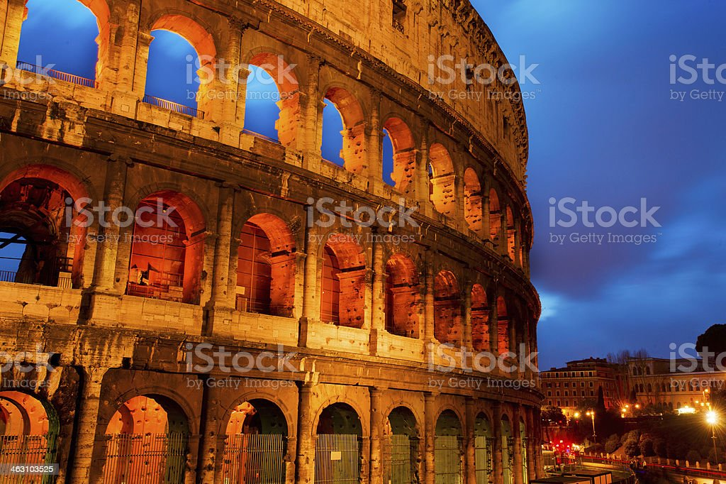 Coliseum by night with traffic, Rome Italy stock photo