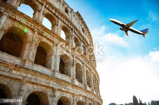 istock Coliseum in Rome Close Up with Airplane 1054301494