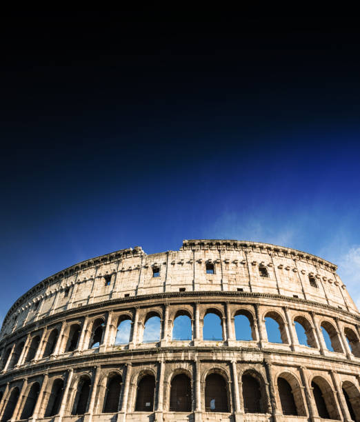 coliseum in rome with blue sky stock photo