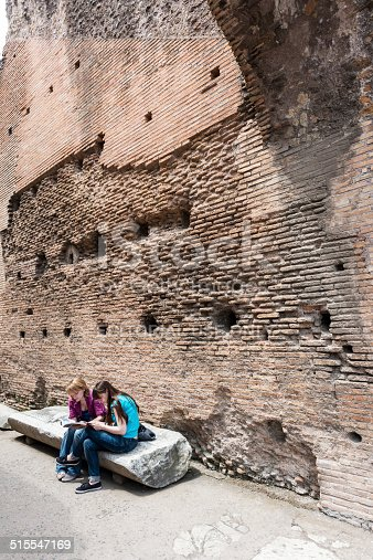 Rome, Italy - May 31, 2014: Wide angle view from Coliseum inside and girl students are doing homework in the Coliseum, Rome.