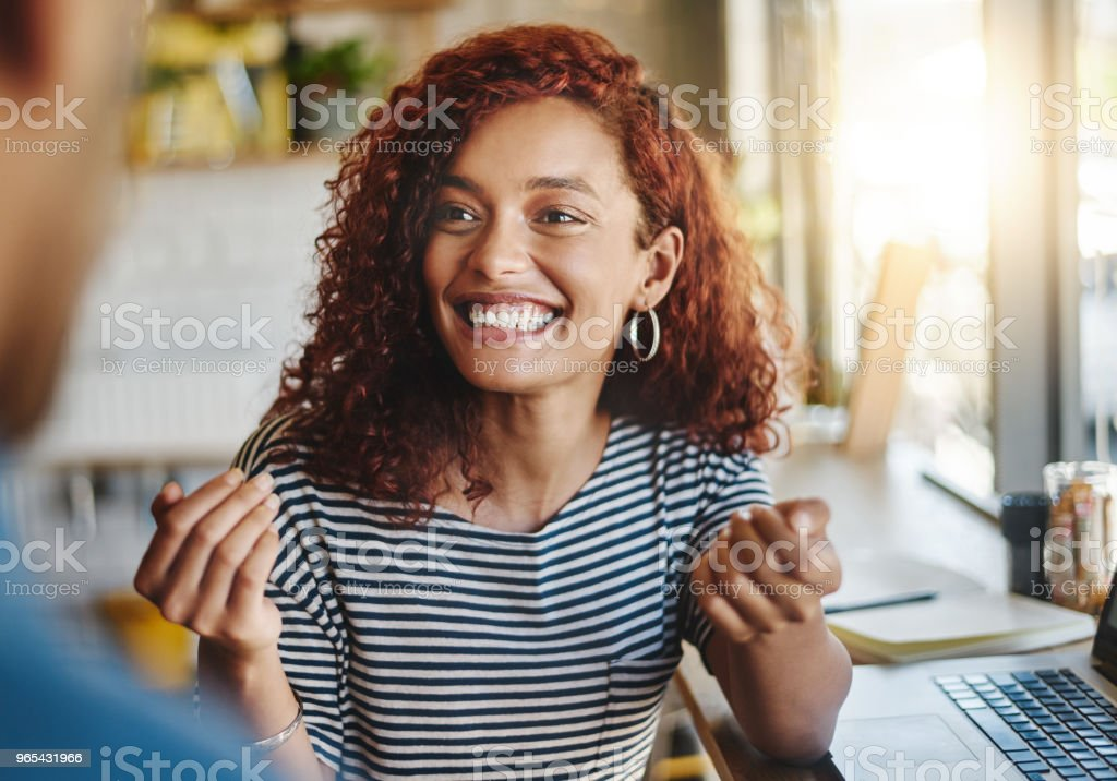 Collaborating at their local cafe royalty-free stock photo
