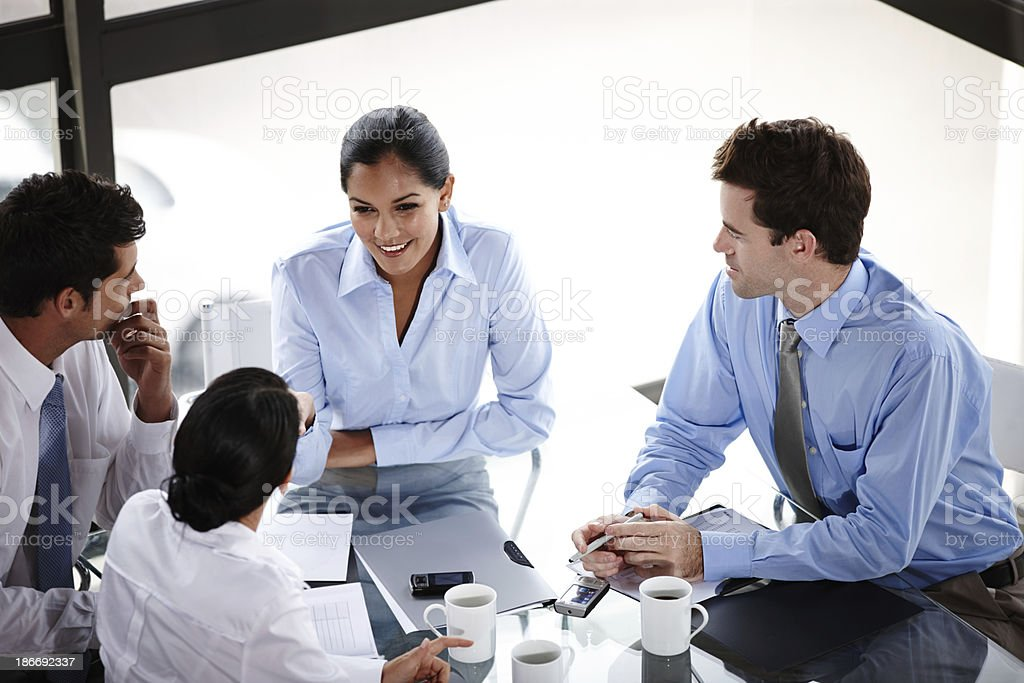 Collaborating in the boardroom royalty-free stock photo
