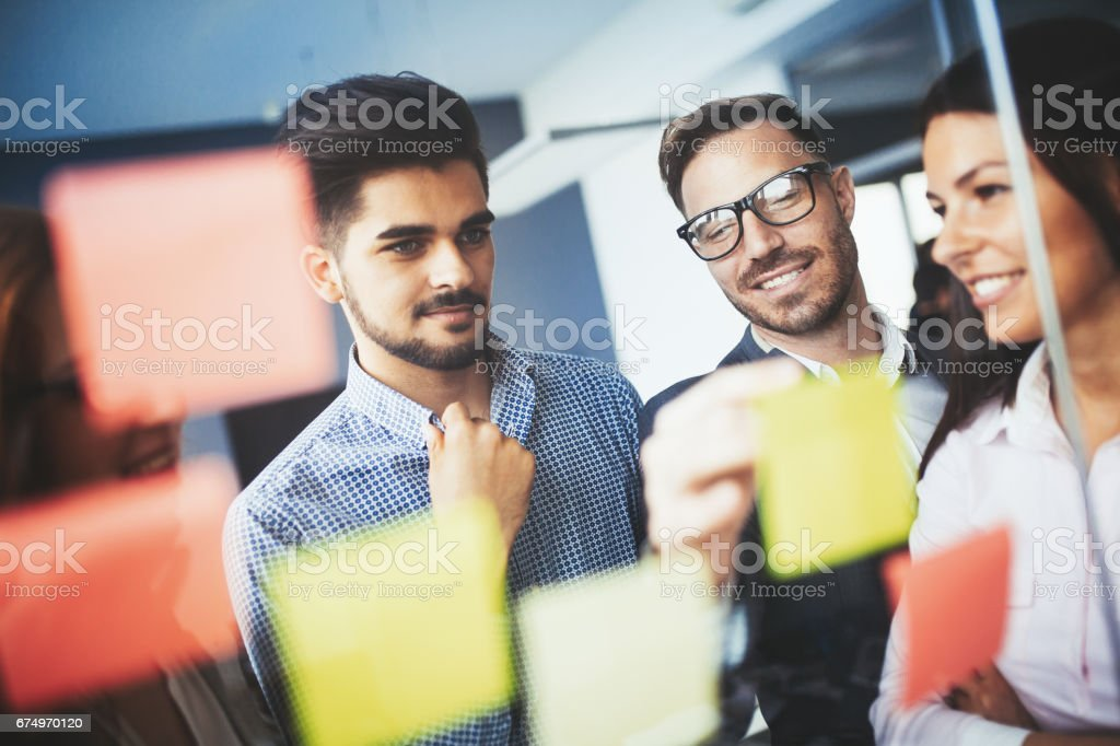 Collaboration and analysis by business people working in business office stock photo
