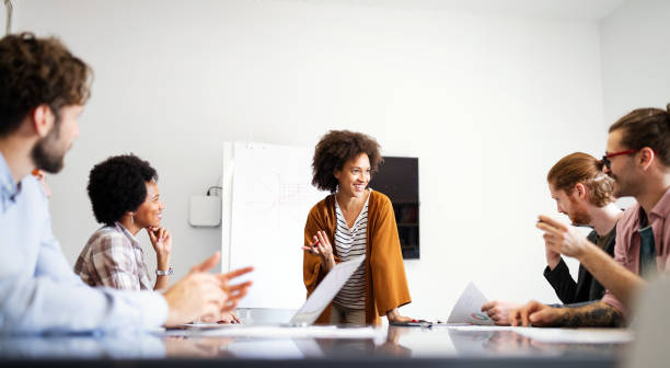 Collaboration and analysis by business people working in office stock photo