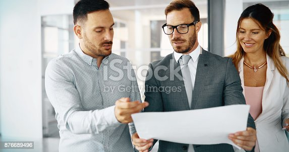 istock Collaboration and analysis by business people working in office 876689496