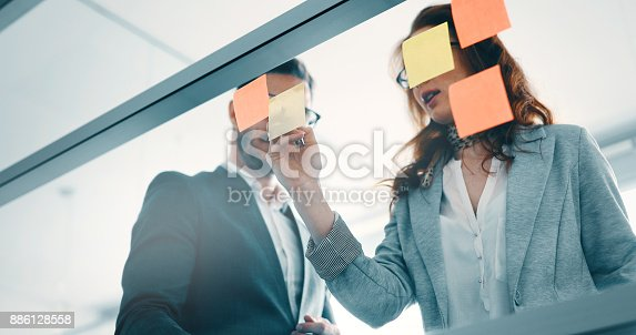istock Collaboration and analysis by business people working in office 886128558