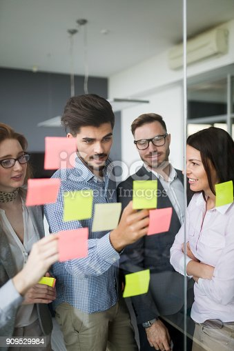 istock Collaboration and analysis by business people working in office 909529984