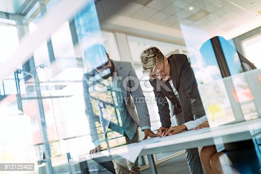 istock Collaboration and analysis by business people working in office 912125402