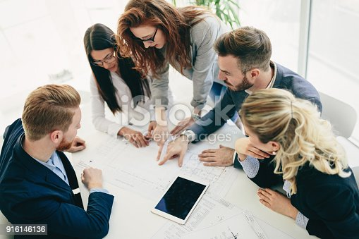 istock Collaboration and analysis by business people working in office 916146136