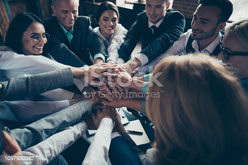 istock Collaboration cooperation power strength lifestyle executive collar company concept. Close up view photo of excited ecstatic satisfied entrepreneurs financiers make tower using palms 1097930382
