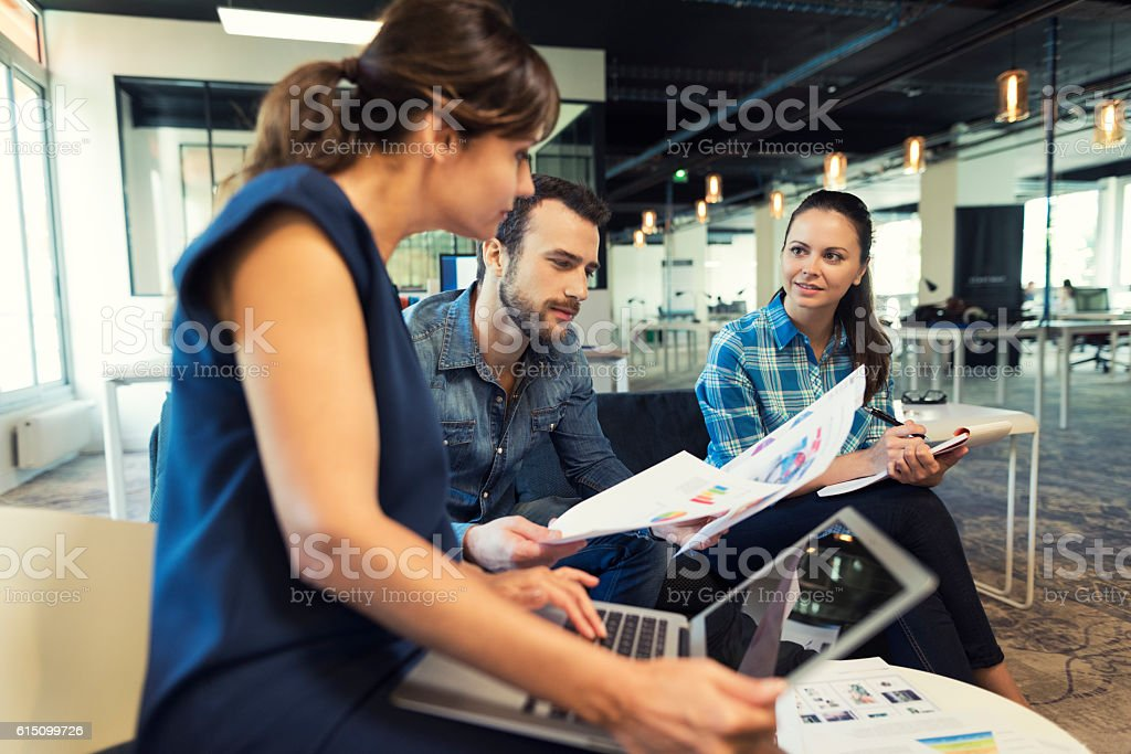 Collaborative teamwork in modern office space stock photo