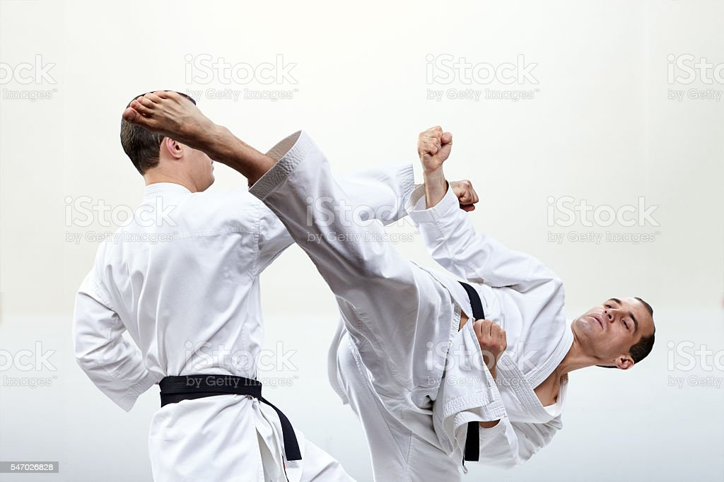 Collage of a punch arm and a kick leg stock photo