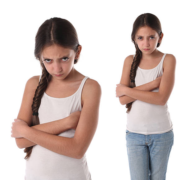 Collage of a young girl very angry. stock photo