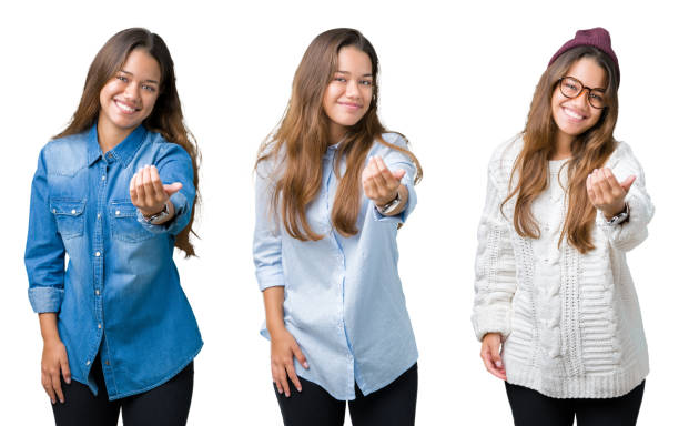 Collage of beautiful young woman over isolated background Beckoning come here gesture with hand inviting happy and smiling stock photo