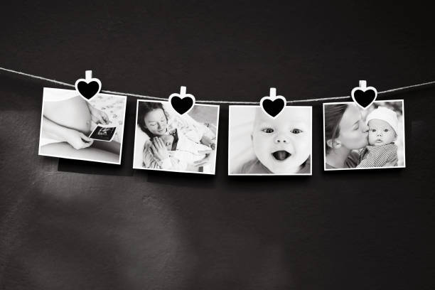 Collage of black and white photos story of a newborn and mother hanging on the clothesline on a textured wall background. stock photo
